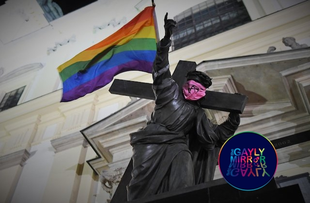 Poland activist group makes over a statue of Jesus Christ with a Rainbow flag